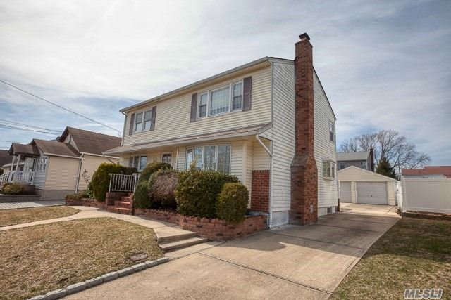 Beautiful Legal 2 Family by C/O, not required to be owner occupied, 5 over 5, great curb appeal w/ brick & vinyl sided exterior, LR w/ fpl, new EIK w/ center island, granite & S/S appliances. Full fin bsmt w/ fbth, refin H/W floors, windows have been replaced, 2 sept electric panels & meters, pull-down attic w/ hideaway stairs, detached 2 car garage, covered bluestone patio, IGS.