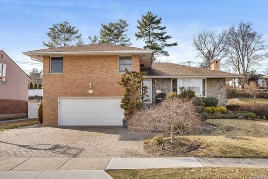 Move Right into this Brick Expanded Split located in Award Winning Jericho SD! 4 bedrooms, 3 full baths, EIK w/ Granite Countertops & Updated SS Appliances, Formal Dining Room & Living Room, 2 fireplaces - Lower Level & Den w/Terrazzo Floor. Full Basement w/ Laundry Rm, Awesome Entertaining Yard w/In-Ground Pool, Updated Roof, New CAC, 200 Amp Electric,  IGS, Gas just installed in front of house!