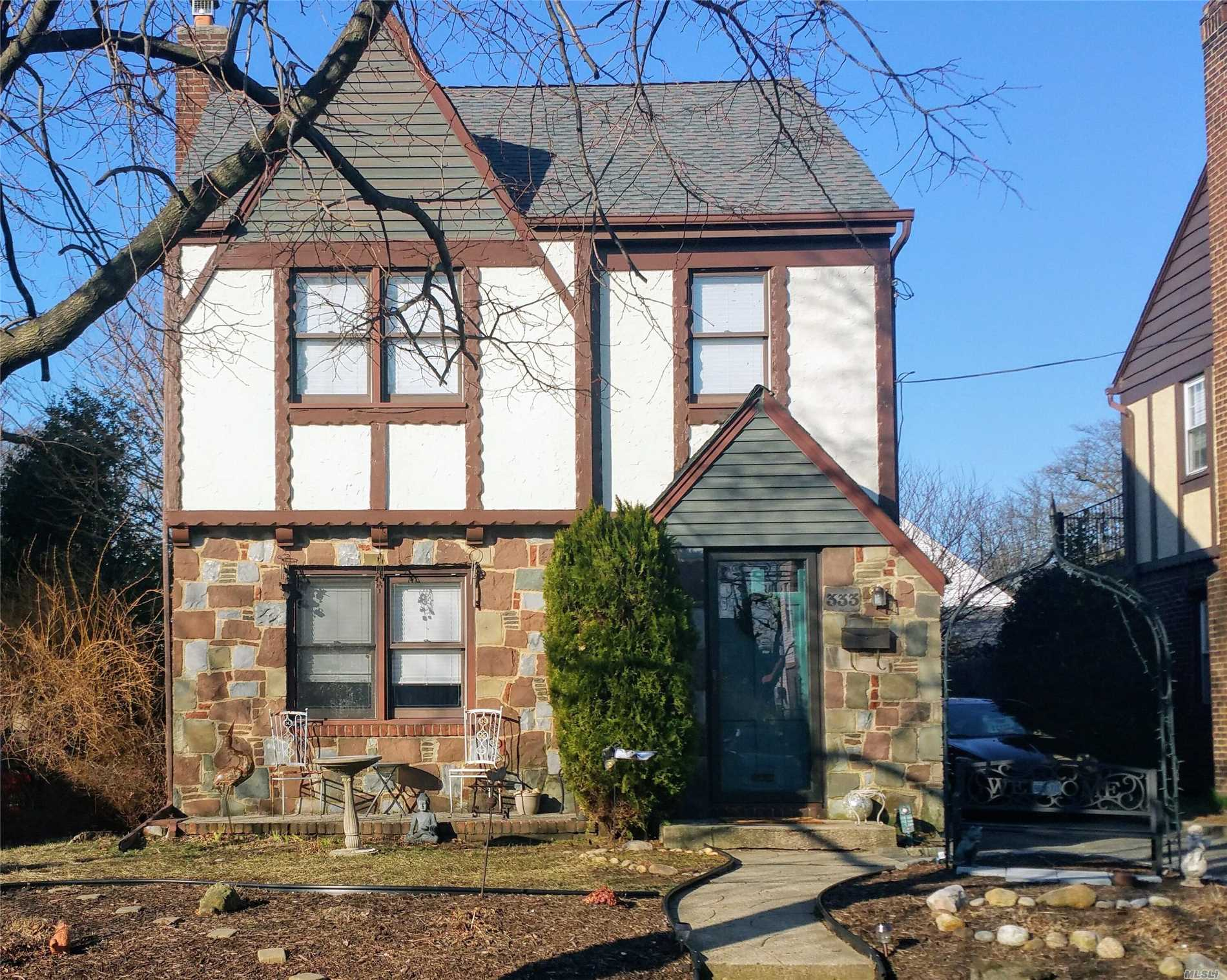 Spacious Tudor Colonial Home! Open Concept Kitchen Family Room With A Wood Burning Fireplace And Vaulted Ceiling. Charming Details,  French Doors, Wood Floors And Wood Mouldings Second Floor Has 3 Bedrooms And A Full Bath. Mineola Amenities Include Pool, Library, Park With Gazebo For Summer Concerts. 33 Minute Commute On Express Trains To Nyc. Brand New Roof W/ Warranty