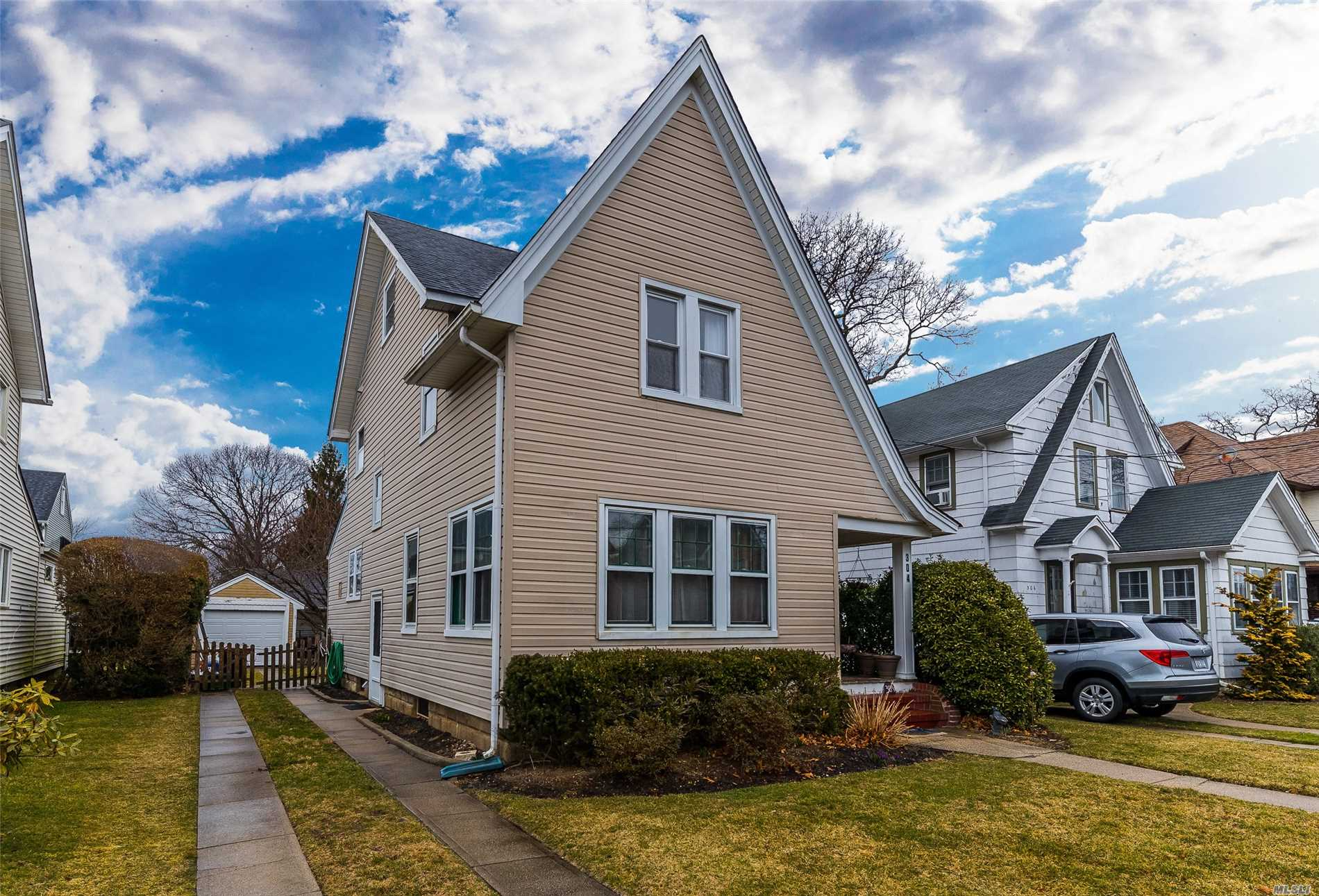 Charming Side Hall Colonial Offering a Living Room With Fireplace, Formal Dining Room, Eat-In Kitchen leading to a Deck with a Nice Yard, 3 Bedrooms, Formal Dining Room, Den, Walk-Up Attic, Basement with New Gas Boiler and Hot Water Heater.