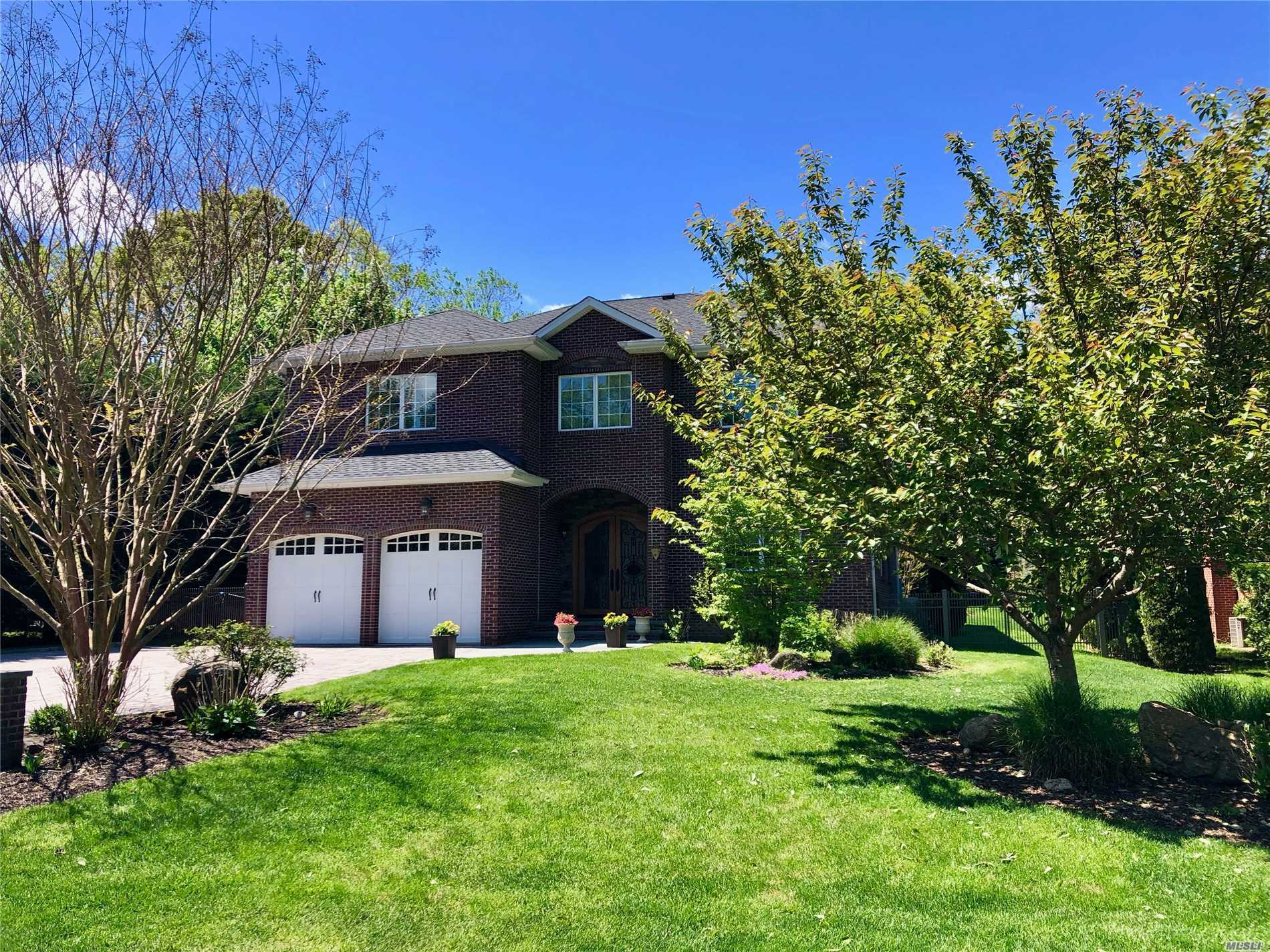 New To Market! This luxury 10-year young BRICK Center Hall Colonial boasts 4 bedrooms, 4 baths, office, family room, 'homework room', 2nd fl study, radiant heat throughout incl finished basement! Situated on a flat .42 acre with room for pool, mid-block in desirable North Shore Acres. This 4500 sq ft residence offers a perfect layout with quality finishes, gas line for Master fireplace, outdoor kitchen, 'wired for everything', tiled heated 2-car garage.Part Of Award-Winning North Shore Schools.