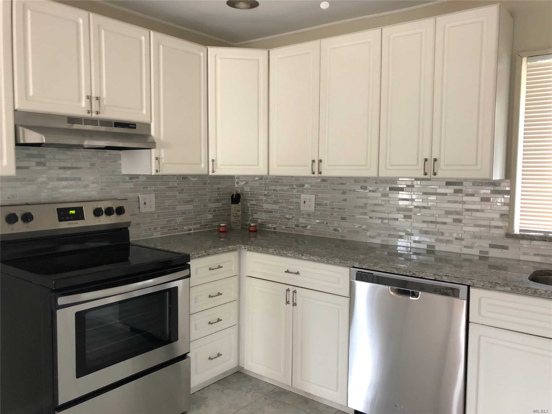 Renovated, Magnificent 5 Bedroom, 3.5 Bath Home In Desirable Area Of Hicksville. Many Updates: New SS Appliances, Granite Counter, New Washer/ Dryer, Freshly Painted Throughout, Crown Molding, Updated Baths, New Laminate Floors On 1st Level & Refinished Wood Floors On 2nd Level, New Vinyl Fence, New Boiler, New Electrical Service With Generator Plug. Open Floor Plan, Plenty Of Closets. Bright & Spacious. Must See! Taxes are in the process of being grieved. Mother/daughter with proper permits.