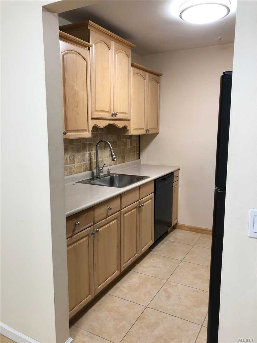 Freshly painted lower unit. Brand new wood laminate floor throughout. Updated bath with new vanity and toilet. Windows and AC units replaced within the last couple of years. Building had new generators installed. Complex has in ground pool, tennis courts, and clubhouse