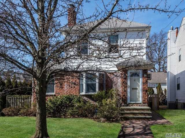 Updated and expanded 3 Bedroom Colonial with a great family room addition, office, living room with fireplace, hardwood floors, detached garage and nice yard in the heart of town, very convenient to shops and train.