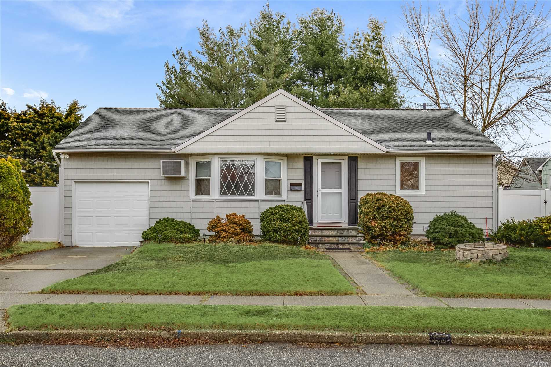 Well maintained sunshine filled spacious Ranch, full finished bsmt/OSE, Lg Lr, Large Eik - Gas cooking, Updates-Refinished hardwood floors thruout, Newer Roof, siding, Dryer, mostly Andersen Windows, elec 150 amp, PVC fence, new Sewer connection, attached Garage,  Close proximity To Train stations, Mall, Shopping, Major Hwys, Not in flood zone, Charles Champagne Bethpage schools