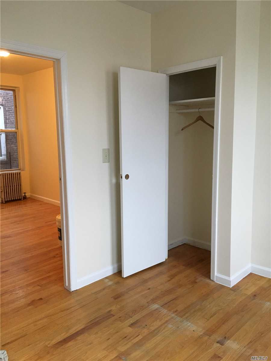 Bright & Light Large Two Bedroom Apartment On The Third Floor In A Multifamily Home In Maspeth. Two Spacious Bedrooms, Living Room, Additional Room, Full Bath & Eat In Kitchen. Hardwood Floors Through Out. New Kitchen Appliances Including Microwave Oven, Oven & Fridge. Renovated Bathroom.
