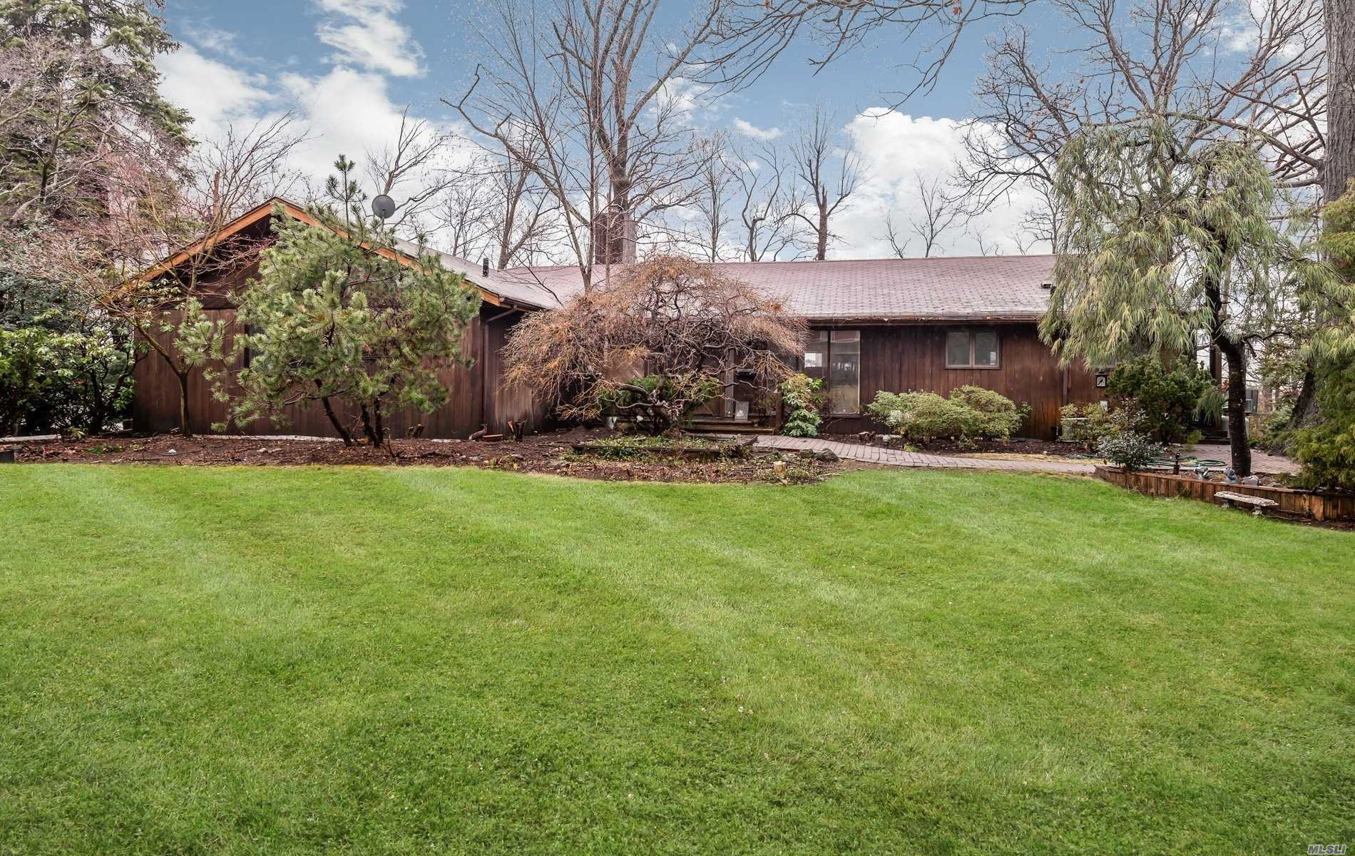 Bring your contractor and bring your imagination. Diamond in the rough. Tons of potential to turn this home into a show stopper. High ceilings, large rooms, lots of light, Living rm, FDR, den with stone fireplace, true Master Suite w/fpl, 3 add bedrooms, 2 bath, large lower level. Great Country Estates location. East Hills Park. Taxes are being Grieved.