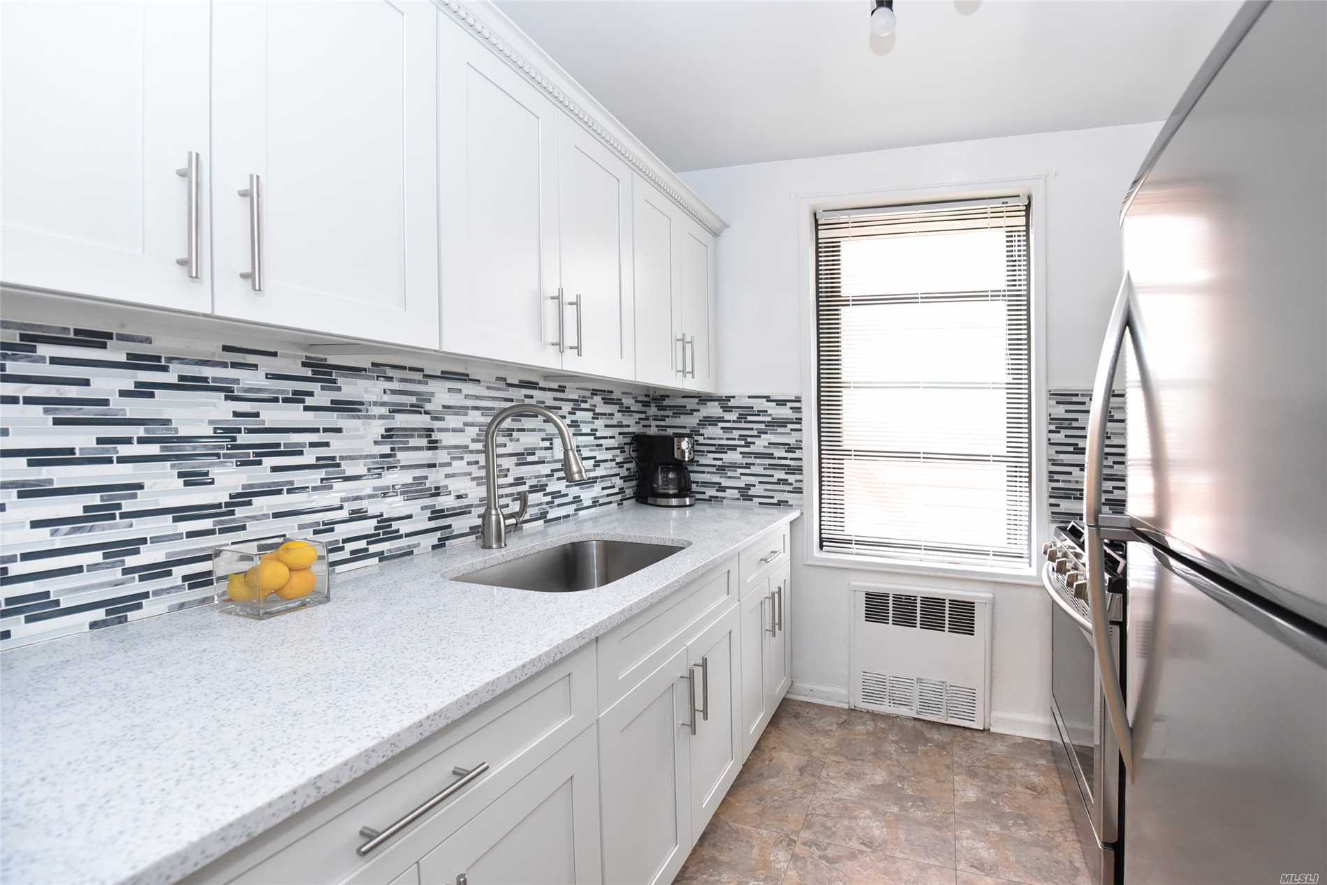 This is a large and renovated 1 bedroom 1 bath corner unit in the Eden Rock building. Windows all around, this south facing units offers an abundance of natural sunlight throughout the entire day. This pet friendly building features a doorman, laundry room, and a 24 hour gym. Conveniently located within minutes to buses, transportation, shopping, Briarwood Station, and the E and F trains.