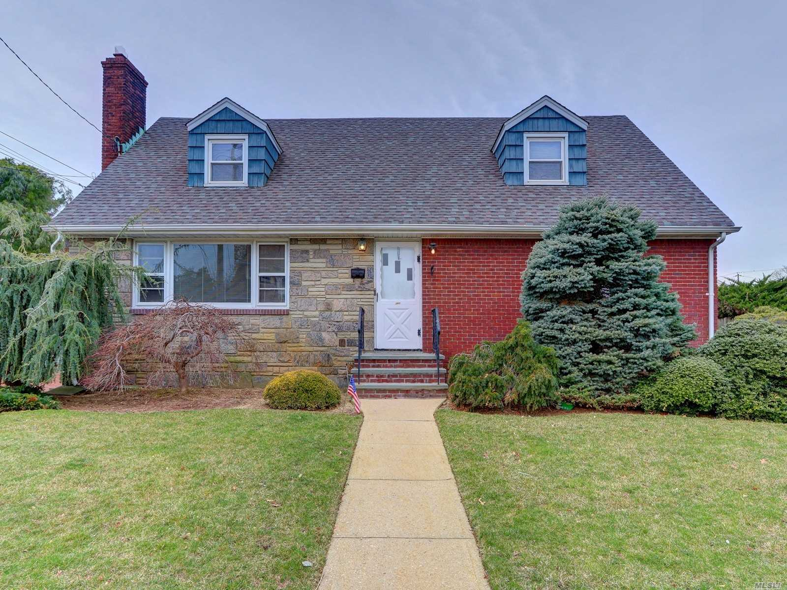 Expanded Cape Style Home. This Home Features 5 Bedrooms, 2.5 Full Baths, Dining Room, Kitchen & 2.5 Car Garage. Centrally Located To All. Don't Miss This Opportunity!