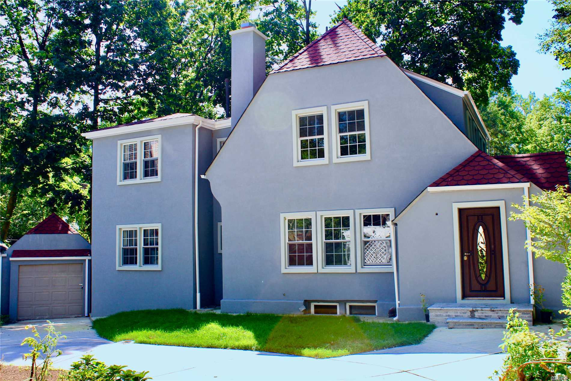Large charming colonial -- Totally renovated! New modern kitchen, 5 full modern baths tiled, new windows, new mahganey floors, every door is new, modern lighting new heating system, new cac, new roof, new stucco. fiinished basement. Nestled in the end of the cul de sac- very private and very quiet. BLOCK away from Forest Park and minutes from train, subway houses of worship and shoppingl. All information deemed reliable but broker assumes no responsibility for information