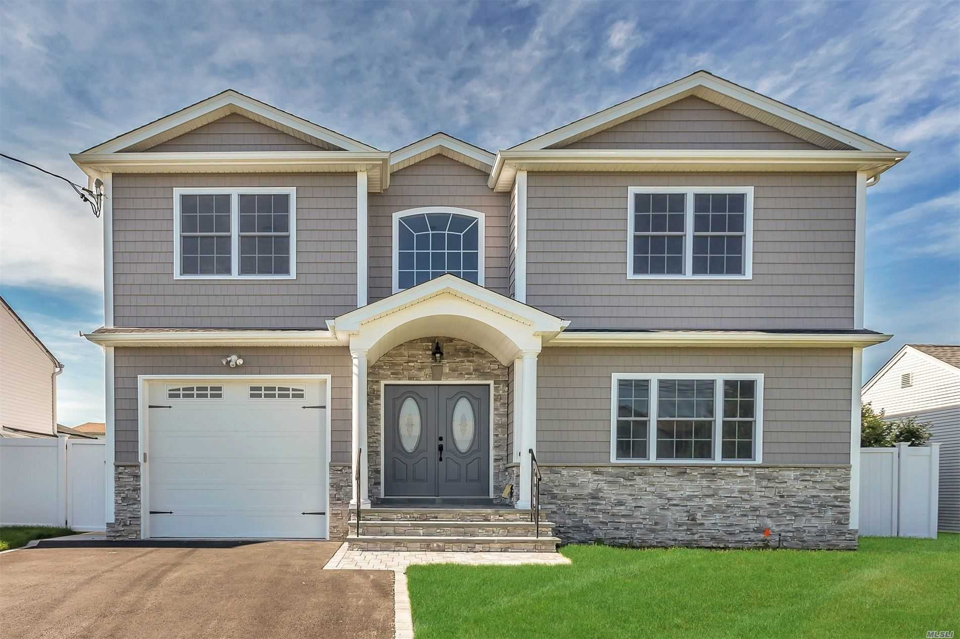 Stunning New Construction! Center-Hall Colonial W/4 Spacious Bedrooms & 2.5 Baths. Late Spring Completion! Entry Leads To open & bright layout w/Living Rm, Formal Dining Rm, Den W/Fireplace, Gourmet Eik w/Gas, Guest Bath. Master Suite W/Lux Full Bath Plus 3 Bedrooms & Full Bath! Incredible Attention To Details & Workmanship! Close To Shopping & Transportation! Time to Customize & Make this your Dream Home! Pictures are not exact-example of other homes!