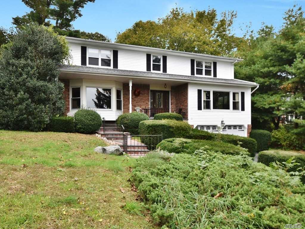Large lovely center hall colonial w/great year round waterviews in quiet cul-de-sac. Over 3000 sq feet of space, 4/5 Bedrooms including a master suite with large closet area and full bathroom. Multiple entertaining rooms, wood floors, private deeded mooring rights with add'l fees, Harborfields school district. Close proximity to town beaches, shops, dining and more! Don't miss this great opportunity!