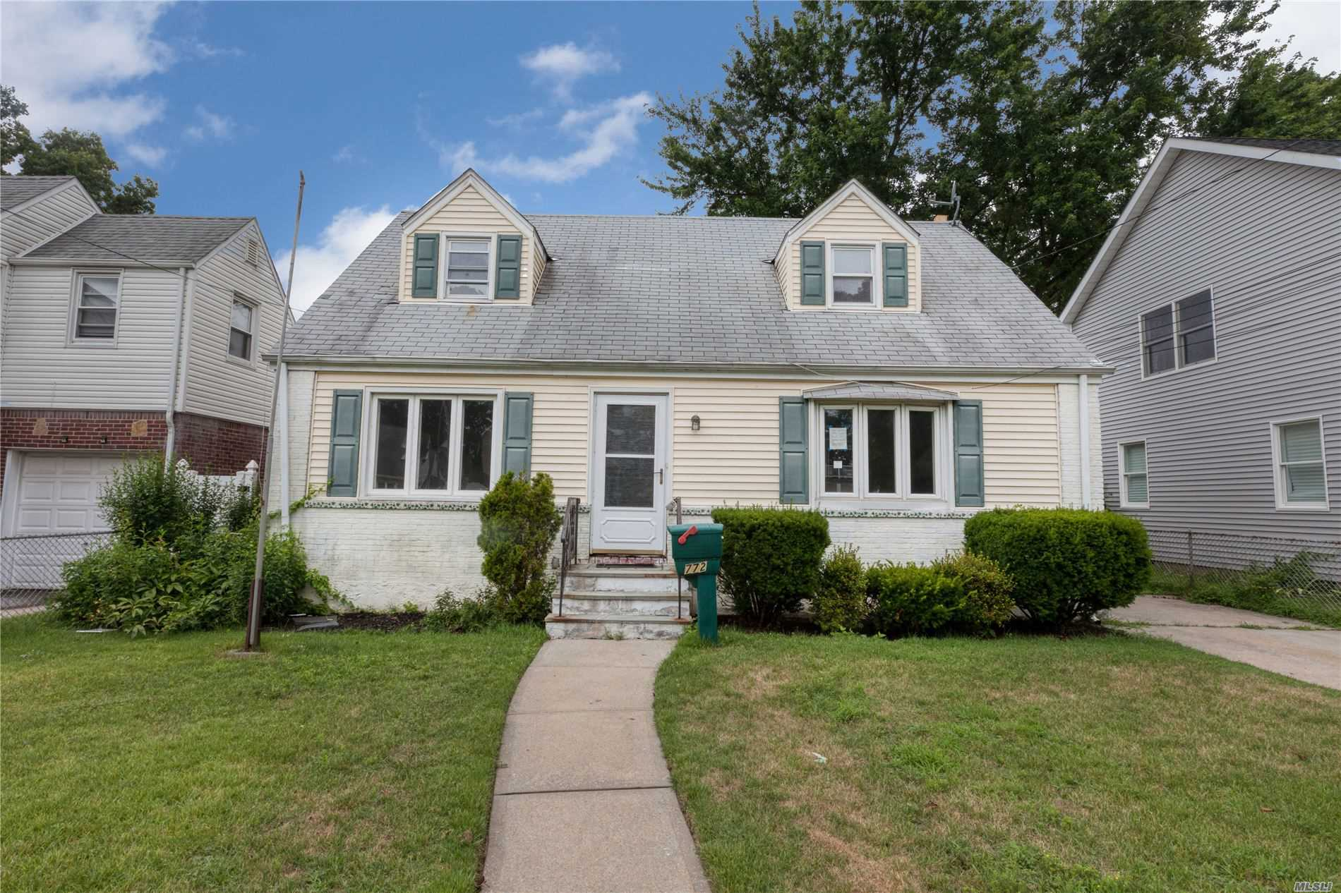Cape with 3 Bedrooms and 1 bath, Full Basement. Large Backyard with Covered Patio and 1 car detached garage. Close to Shopping, Transportation and Major Roadways