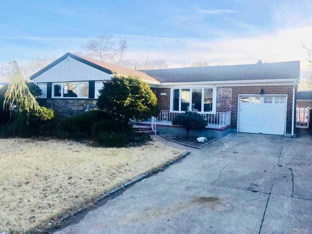 Completely Renovated Ranch In Elmont With Open Layout Featureing Three Bedrooms, Two Baths, LR/DA, Eat-in-Kitchen, Stainless Steel Appliances, Granite Countertops, Hardwood Floors, Finished Basement, Fenced Yard and One Car Garage. Lovely Treeline Neighborhood. Convenient Location Near All.