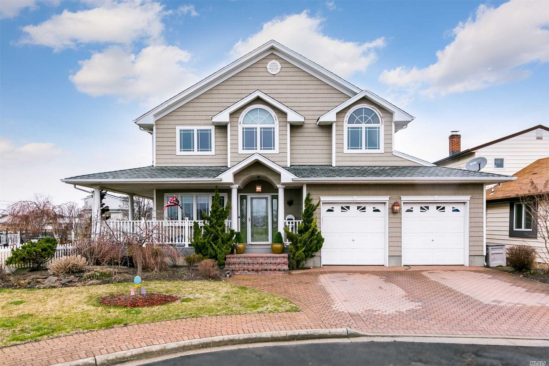 Stunning Custom Built 4 BR, 2.5 BATH, *3, 800 SQ FT Colonial on Deep Wide Canal with View of Channel- Boaters Dream w/ Waterview Wrap around Porch, Huge Landscaped yard with Dock, Deck, Floats.. can accomodate any size Boat- Minutes to Debbs Inlet --Gourmet Chefs Eat -In- Kitchen w/ Center Island, Formal Dining Room, Spacious Living Room with Gas Fireplace, @ Car Garage, Gas heat(5 Zones) , Radiant heat..