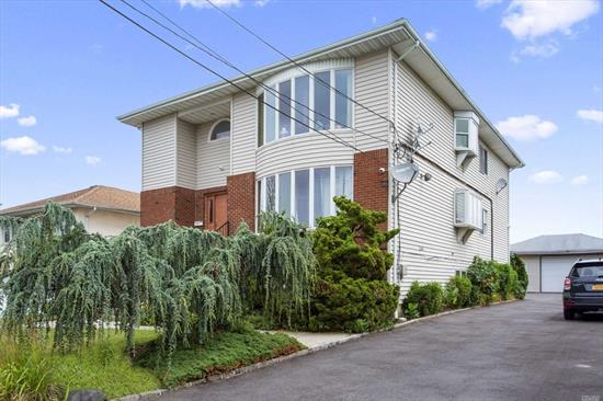 One of a kind sun drenched TWO FAMILY house, large rooms, hardwood floors throughout, each floor has 3 tremendous bedrooms, 4 bathrooms,  master bedroom,  2 eating kitchens, 2 living rooms, 2 dining rooms, tons of closets, 3 car garage, CAC .Walking distance to houses of worships, shoppings, transportation, Must see to appreciate !!!