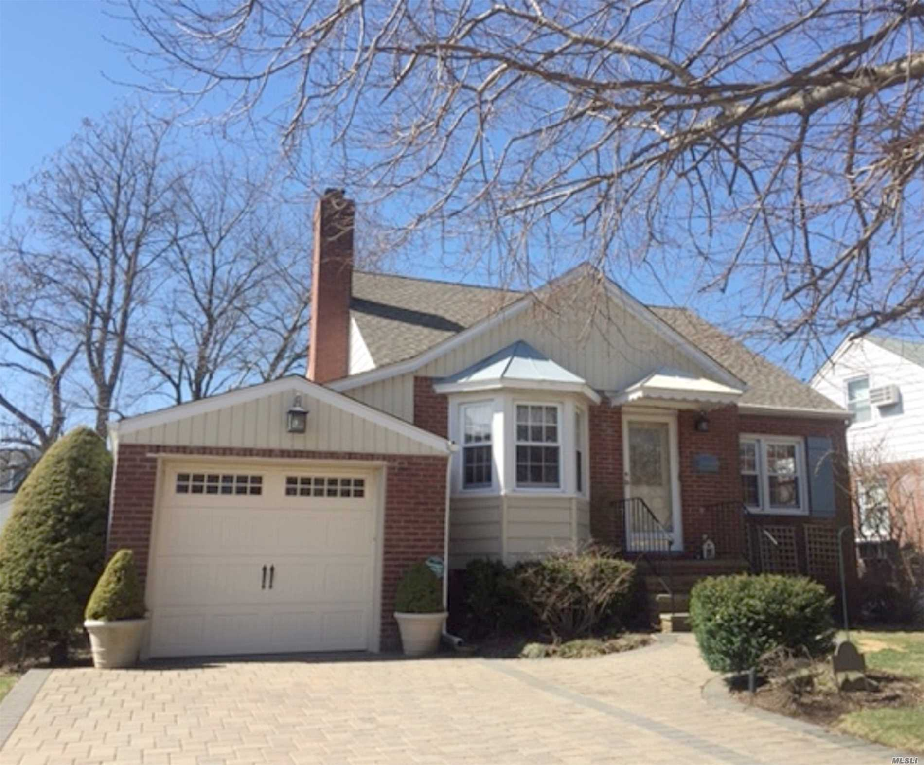 Come see this beautiful, move-in ready Exp-cape in SD#20. Large rooms, updated systems including CAC, alarm, IGS, new hot water heater, 200 amp electric, new dryer, new roof, paver driveway, granite and SS appliances in EIK, bright 4 seasons den leading to deck and professionally landscaped yard, plenty of storage and close to LIRR. Nothing to do but unpack and enjoy this true home!