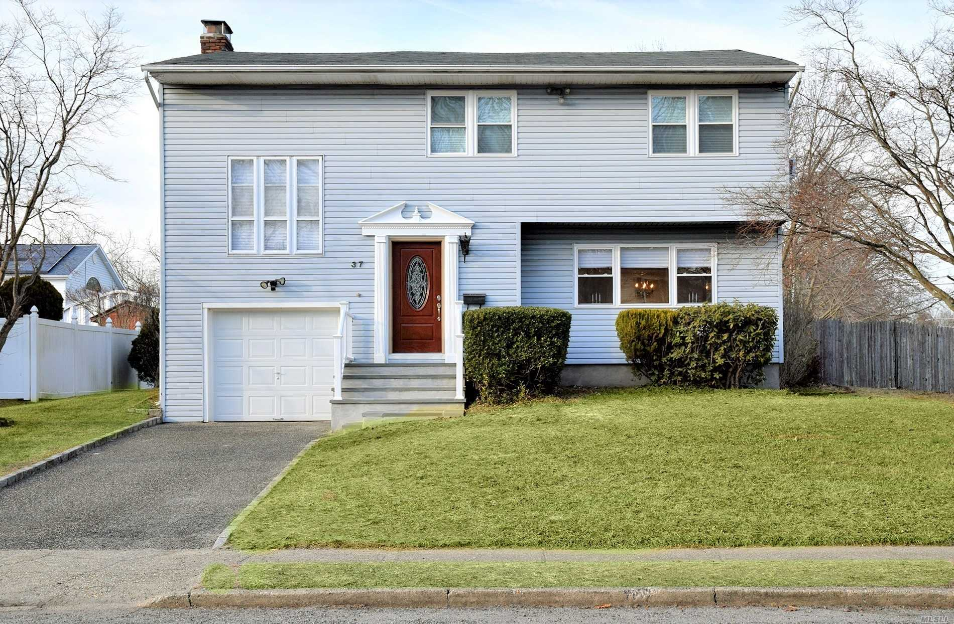 Renovated 1800 Sf Colonial w Open Floor Plan. Beau EIK w New Granite-Backsplash-Cabinets-Wood Floors w Stainless Apls. 9 Spacious Sunlit Rms inc 4 Bedrooms & 2.5 Gorg Baths w Custom Ceramic Tile & New Fixtures. 16' x 13' Mstr BR w Full Bth. New Windows-Doors-Wood Floors-Hi Hats & Freshly Painted. Den w Cathedral Ceiling & Fireplace. Alarm Sys. Bluestone Porch. Large Backyard. Gas Heat Avail on Block. Min to LIRR, LIE & Shopping. Desirable Sachem Schools. Low Taxes, only $7, 836 w Basic Star!