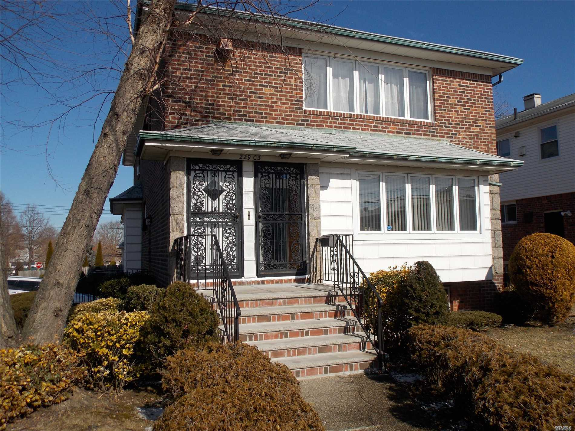Well Kept 2 Family Brick Corner Property With 2 Car Garage. Convenient To Transportation And Shopping. Near Cardozo High School And Queens Borough College.