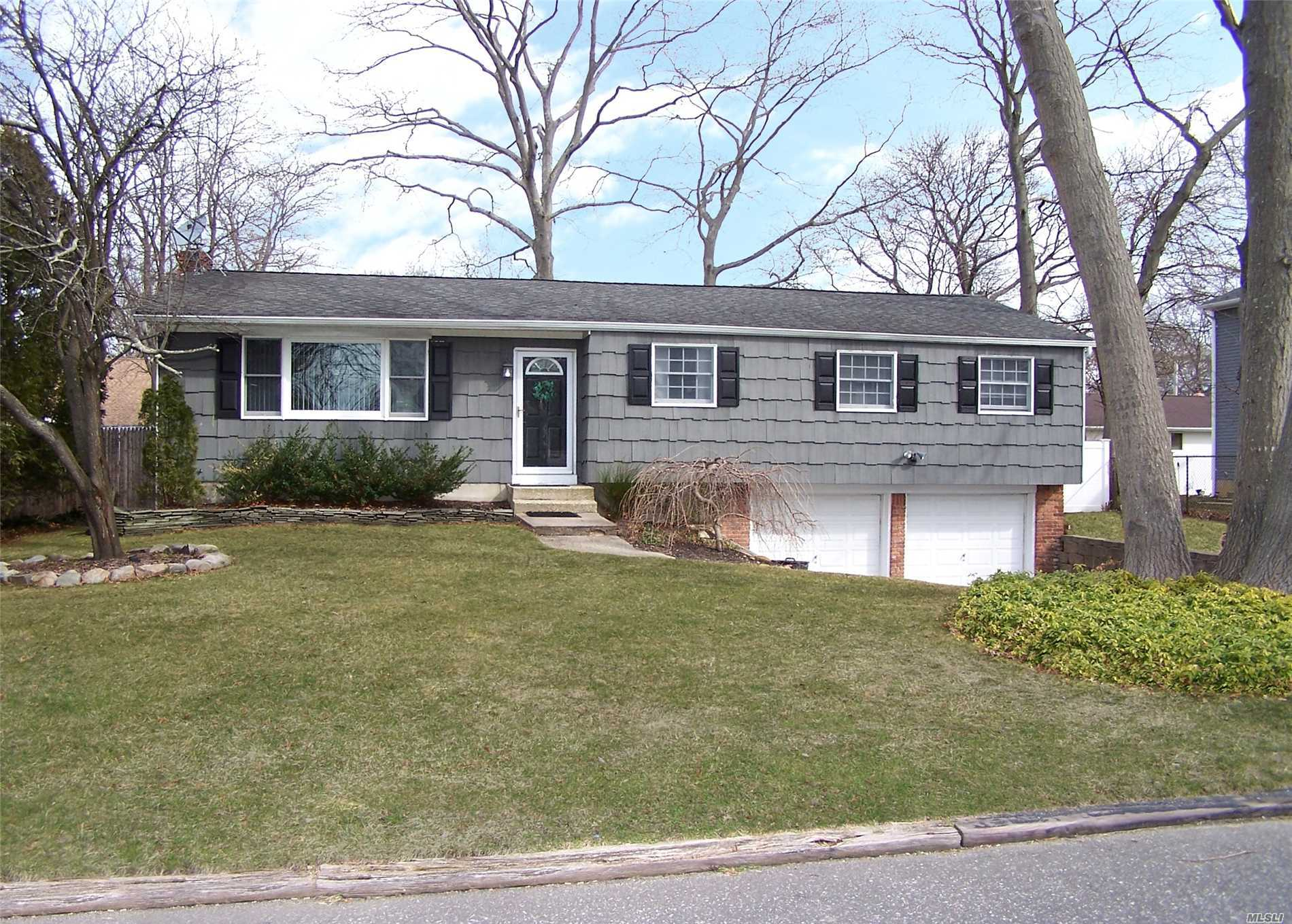 Beautiful, updated, clean ranch. Gorgeous wood floors throughout the main floor. Freshly painted. Featuring 3 bedrooms and 2 updated baths. Large open living room and dining room plus large den. Finished basement and 2 car garage. Close to the LIRR and major highways. Gas is in the street.