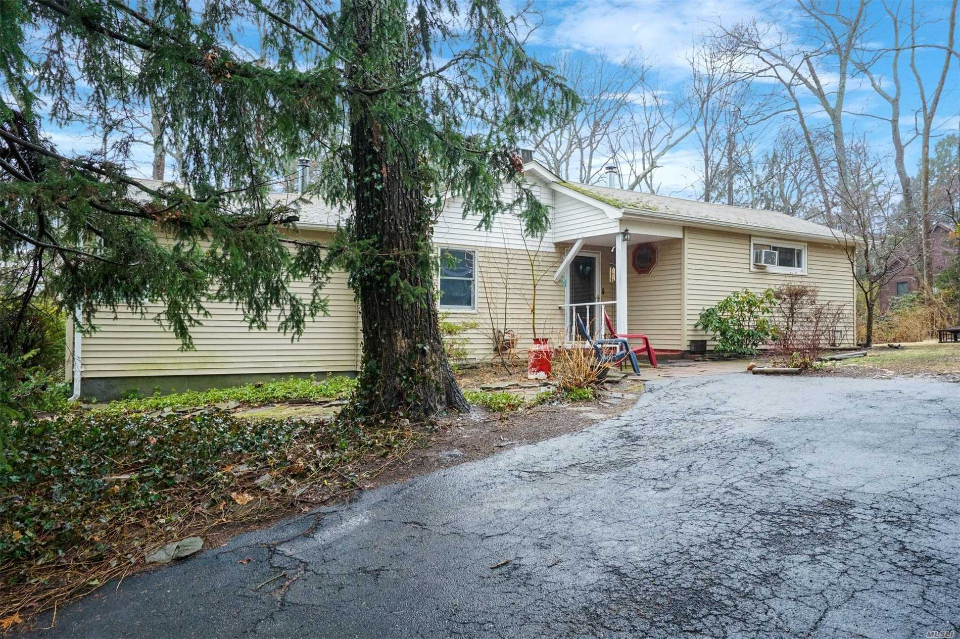 Charming Ranch on a Cul de Sac in the Terraces, a Private Beach Community. Living Room w/Frpl & Cathedral Ceiling, Den, New Bath w/Skylight, Wainscotting Walls, 2 Wood Stoves, Deeded Beach Rights. Refrigerator to be Replaced.