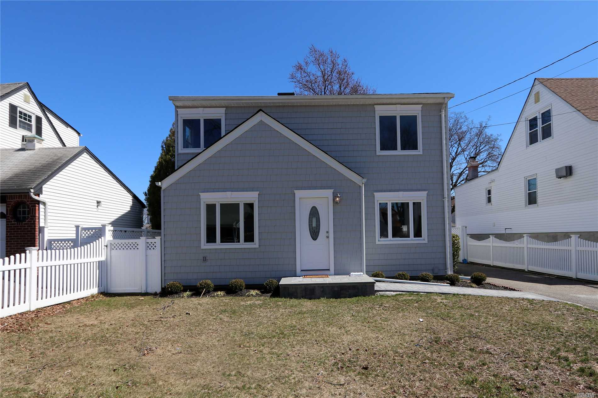 Beautiful renovated 4 BR colonial in South Seaford. This home features an Open Concept, beautiful kitchen with grunite counters stainless steel appliances hardwood floors, new bathrooms and Trex Deck. House is Move-In ready. Flood Zone X -- All you need to do is unpack!!
