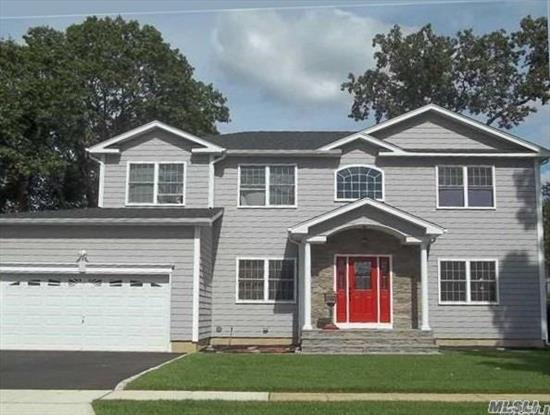 This Fabulous Home Sits in the Heart of Massapequa Pk, Desirable SD#23. Gorgeous Kitchen, Custom Cabinets w/Cent Isl/Sep Dinette Area...9' Ceil/1st Fl...Custom Crown/Box Molding...Designer Baths...Gleaming HW Flrs...Fam Room/Gas Frplc...CAC...IGS...2 Car Gar...All Pictures For Workmanship...Now is the Time to Upgrade and Customize Your Dream Home!