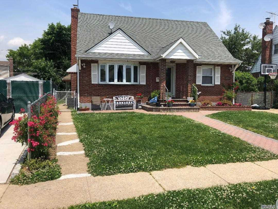 Beautiful Expanded Brick Cape on Tree-Lined Street, Kitchen With Dining Area Overlooks Den Extension and Leads To Private Fenced In Yard.