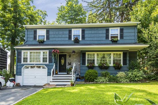 Situated In The Heart Of Huntington Village Off West Neck Road, This Spacious Colonial Has Many Updates Finished Basement, Flat Property With New Fencing And Fabulous Perennial Gardens. Close To Everything.