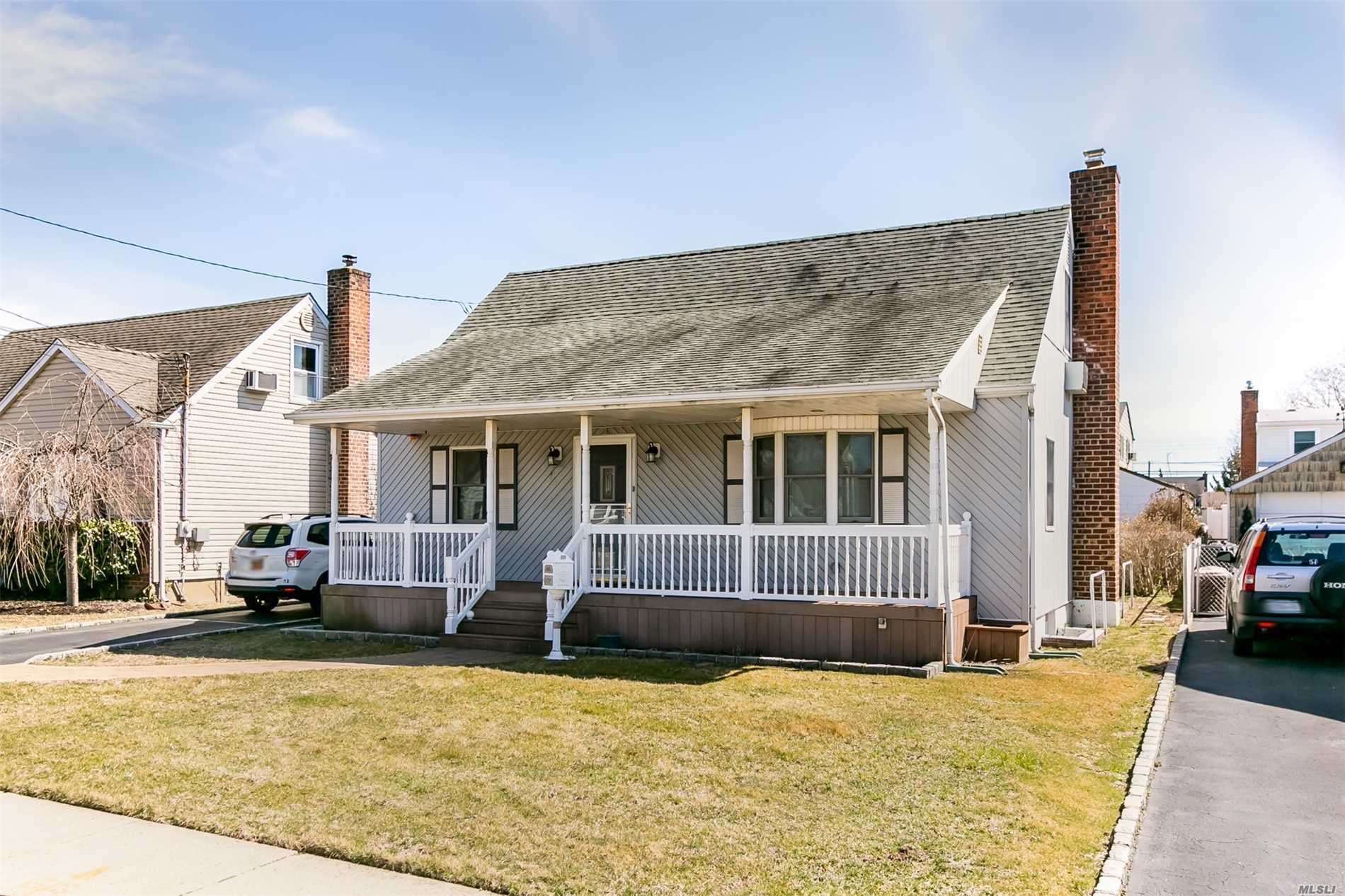 Recently Renovated Cape Featuring Bamboo Hardwood Flooring, 2.5 Baths, Master on 1st Floor. W/D Hook up. Plenty Of Room For Mom. Basement W/Sep Entrance, Beautifully Finished, Front Porch, 2 Car Garage & Private Backyard.Close to LIRR & Village. SUPER LOW TAXES!!