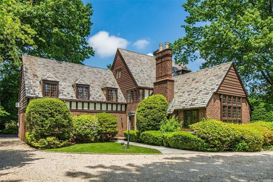 Beautifully Appointed 4-Bed, 3.55 Bath Tudor Style Home On Park Like Grounds. Set Mid-Block On Private 100X251 Landscaped Property In Desired Central Section W/Room For Pool. This Stately Home Features Unique Millwork & Architectural Details Inside & Out. Boasting 3 Levels Of Living Space Plus Lrge Partially Finished Basement, 2 Fireplaces, Slate Roof, Radiant Heated Floor, Gas Stove.