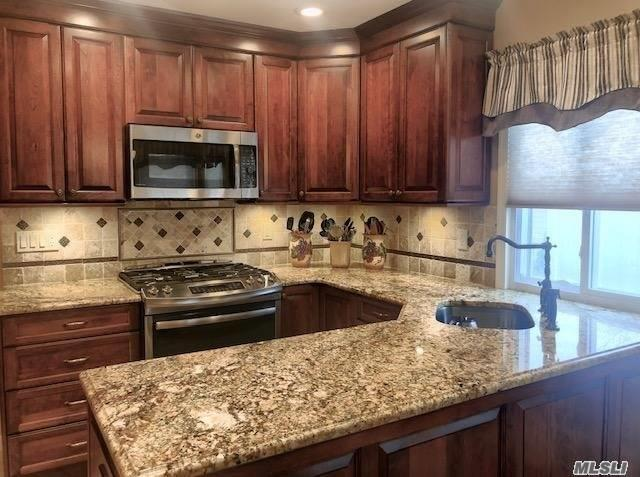 Mint plus condition Warwick model with fabulous new kitchen! New Cortec hardwood floors, windows, doors, electric, hi hats and custom window treatments. Newer CAC and heating. All new appliances. VERY private location, patio, backs to woods. This beauty WON'T LAST!
