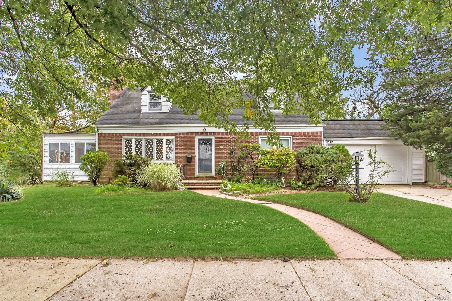 Spacious Well Kept Cape, Features 4 Bedrooms , 2Full Baths, Living Room, Formal Dining Room, Eat In Kitchen, Beautiful Den With Skylights Great Size Backyard. Attached Car Garage With Private Drive Way. Walk To Malverne Train Station & Town. Taxes are being grieved.
