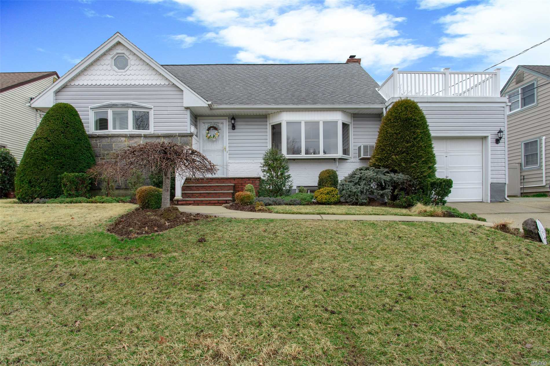 Meticulously maintained Cape in Oceanside S.D. Living Room with Gas Fireplace, Updated Kitchen w/ss appliances, Formal Dining Room, Den with Gas Fireplace, 4 Bedroom, 2 Full Baths, Hardwood Floors Throughout. Finished Basement, Beautiful backyard with in-ground pool. Fantastic for entertaining.