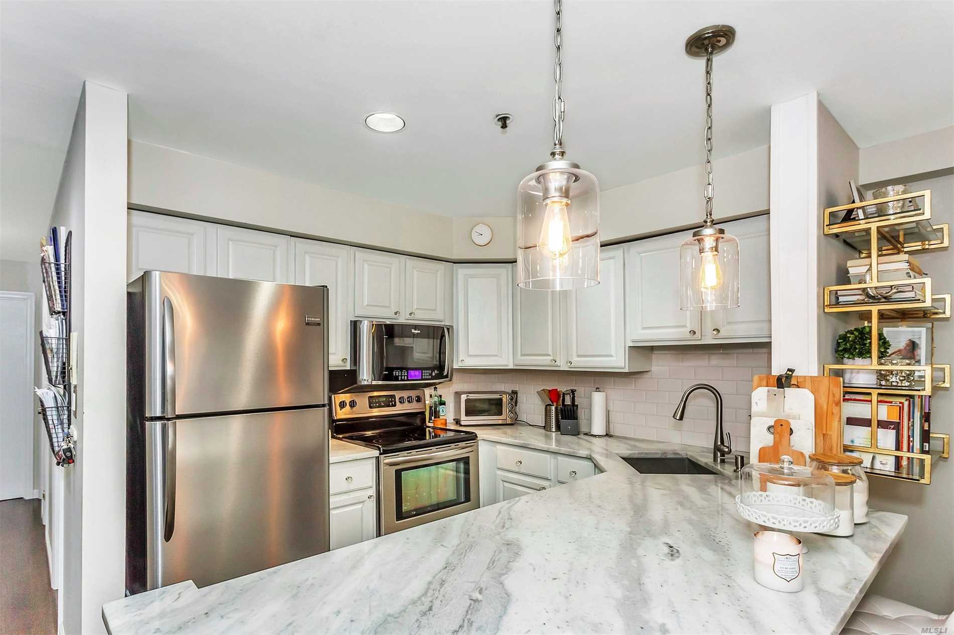 One of a kind, beautifully renovated open concept 2 bedroom condo, with a large terrace. Sunny open floor plan, perfect for entertaining with a chefs kitchen, including quartzite and stainless steel. Brand new bathroom and solid hardwood floors throughout. Blue Ribbon Lynbrook School district #20. Centrally located close to trains, highways, schools, shopping and places of worship! Come see your new home today!