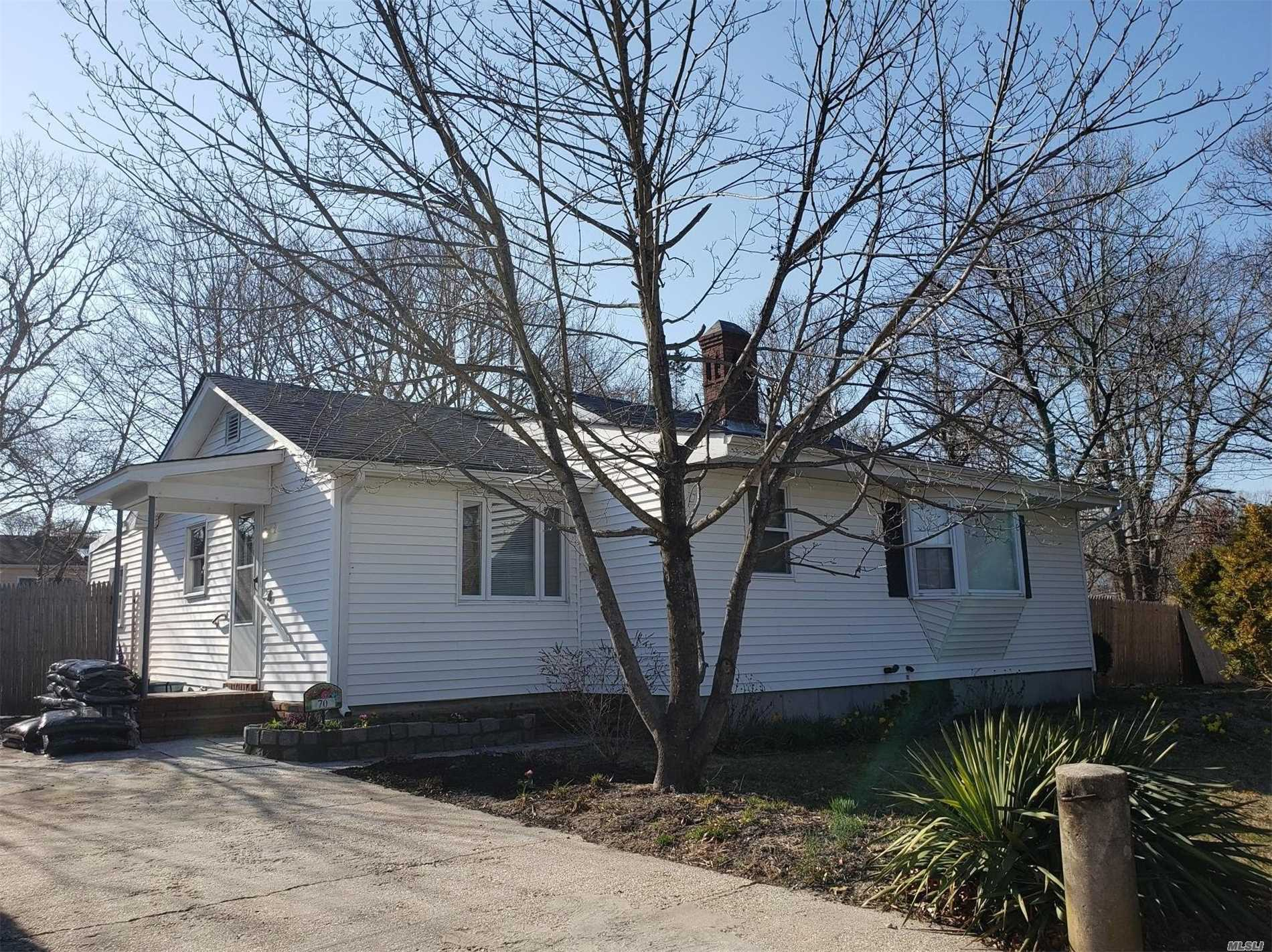 DEAL DIED ! LOW TAXES ! COMMUTERS DREAM ! This 3 bedroom Ranch Home is Located on 180x100 lot w/ Fenced in Yard . Features include a Spacious eat in kitchen w/ Oak Cabinets , NEW Dishwasher, Wall Oven & Sky Light Offering Lots of Natural Light; 2 NEW Full Bathrooms w/ Waterproof Wood Flooring & Ceramic Tile Shower including a custom Glass Tile Design, Wide Shower Base & Sky Light. Sizable Living Room w/ Hand Laid Stone Fireplace & Uniquely Designed Chimney, Hardwood Flooring, Laundry Room !