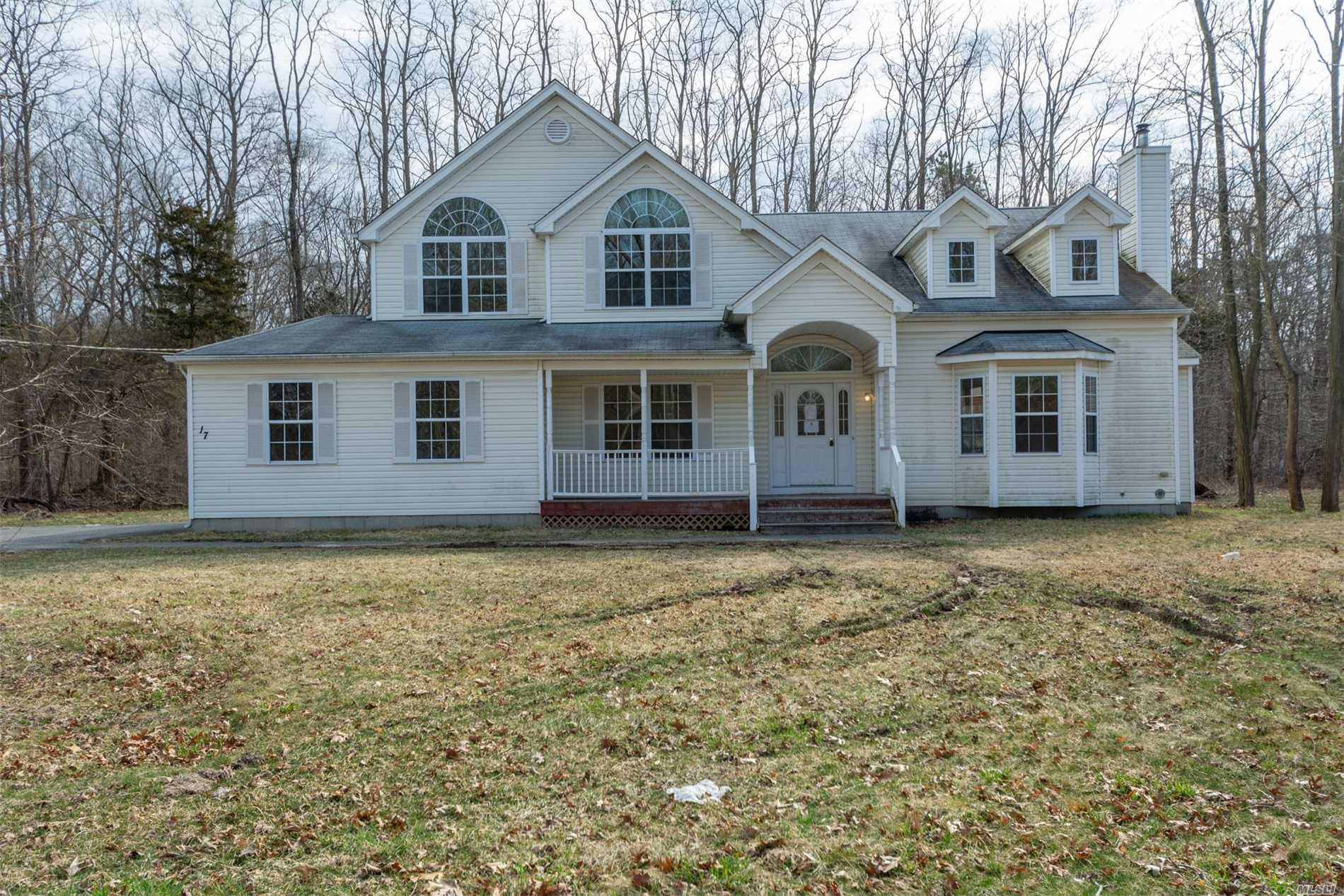 Great young home waiting for a buyer with vision. Large room sizes, hardwood flooring throughout.Garage must be converted back to SFR standards. Outside entry only to basement.Large lot, room for large IGP. Local to everything set back off roadway. Needs work Sold AS IS