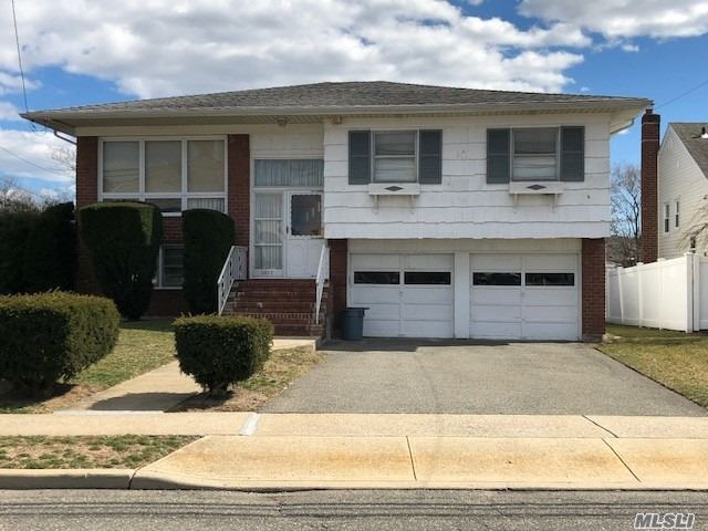 House being sold as-is!!! Turn this wonderful hi ranch house into your dream home! Endless possibilities. Excellent location on quiet street, large flat backyard. 4 bedrooms, 2 full baths, 2 car garage, newer washer/dryer. House needs some TLC, has a wonderful layout.