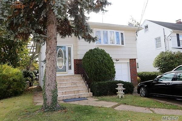 Malverne Named The Safest Community On Long Island, 5th Safest Place In N.Y. Beautiful Open Floor Plan. Canadian Maple Wood Floors, Ss Appliances, Granite Counters, Luxury Baths W/Radiant Heated Floors, Massage Jacuzzi, Shower Body Sprays And Bidets. Huge Master Suite With Cedar Lined Wic, 1st Fl W/Side Entrance, Bistro Dining Area, Spa Like Bath W/Steam Shower & Body Sprays, Lr/Den, Lge Bdrm, Laundry Room. Possible M/D w/ Permits. Taxes were grieved. Nassau County taxes reduced by approx 22%!!!