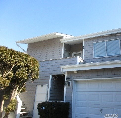 First Floor End Unit. One Car Attached Garage. 2 Bedrooms and 2 Full Baths. Large Vaulted Living Room W/Fireplace.Dining Rm, Eat In Kitchen W/Breakfast Bar.