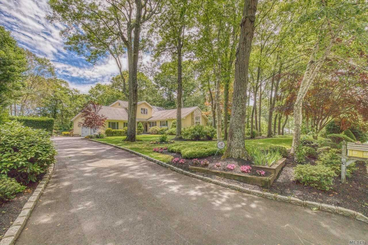 Magnificent 4 Bedroom, 3.5 Bath Farm Ranch Set Back On A Beautifully Secluded 1 Acre Corner Property With New Driveway, Pavers And Garage Doors. Step Out Onto Your Mahogany Deck Into Your Oversized In-Ground Pool. Ideal For Entertaining! Move In Ready, Just In Time For Summer.