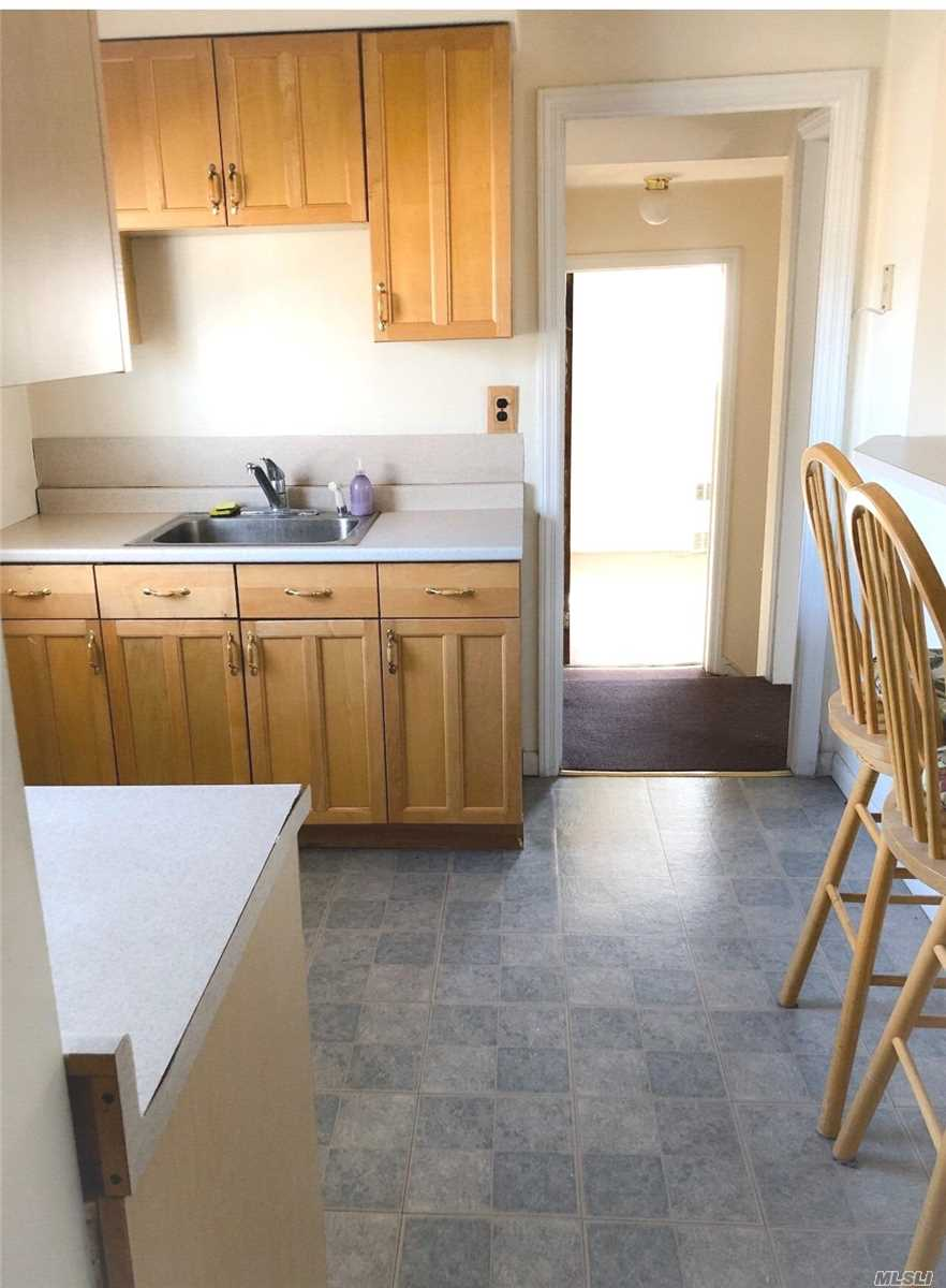 Lynbrook Updated 1 Bedroom Apartment On 2nd Fl, Freshly Painted, Eat In Kitchen w Gas Cooking, Features a Center Island with Seating, Offers a Living Room, Updated Bath, One Bedroom, Heating and Cooking Gas included, Tenant pays electric, Driveway Parking Included.