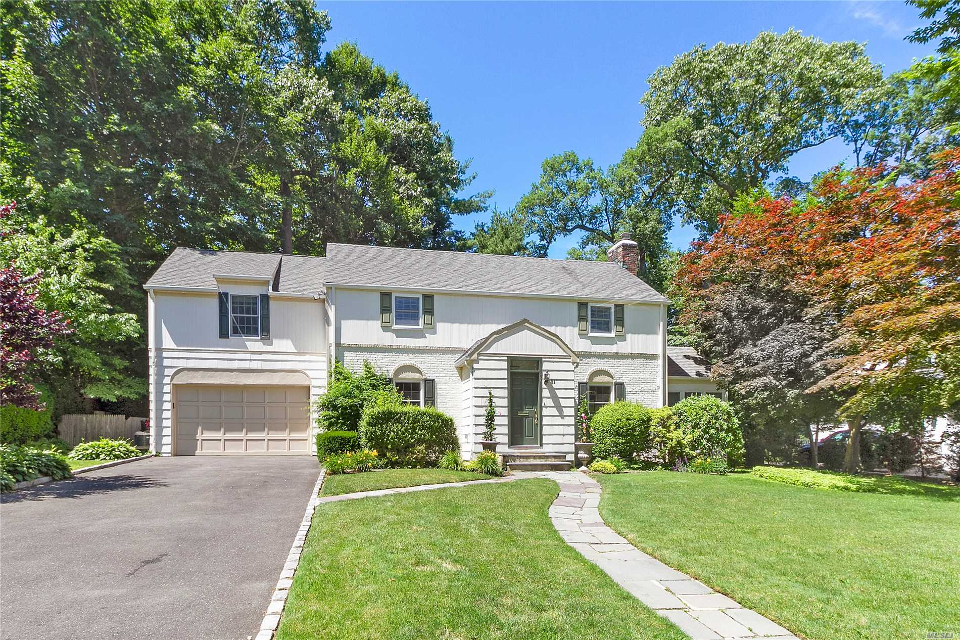 Expanded East Hills Colonial in the Heart of Norgate. This 5 Bedroom Home Features A Fabulous Master En-Suite w/ His and Hers Walk-in Closets and Vaulted Ceiling, 2 Bedrooms W/ Jack And Jill Bath, 2 Add'l Bedrooms & 1 Add'l Bath all up. Bright Windowed Entry, Renovated Kitchen W/ Custom Cabinets, Sun-filled Office, Large Family Room W/ French Doors Leading To A Lush Backyard. Custom Closets, Radiant Floors, Gas Cooking, Full House Gas Generator (2013), Low Taxes, East Hills Park & Roslyn SD!