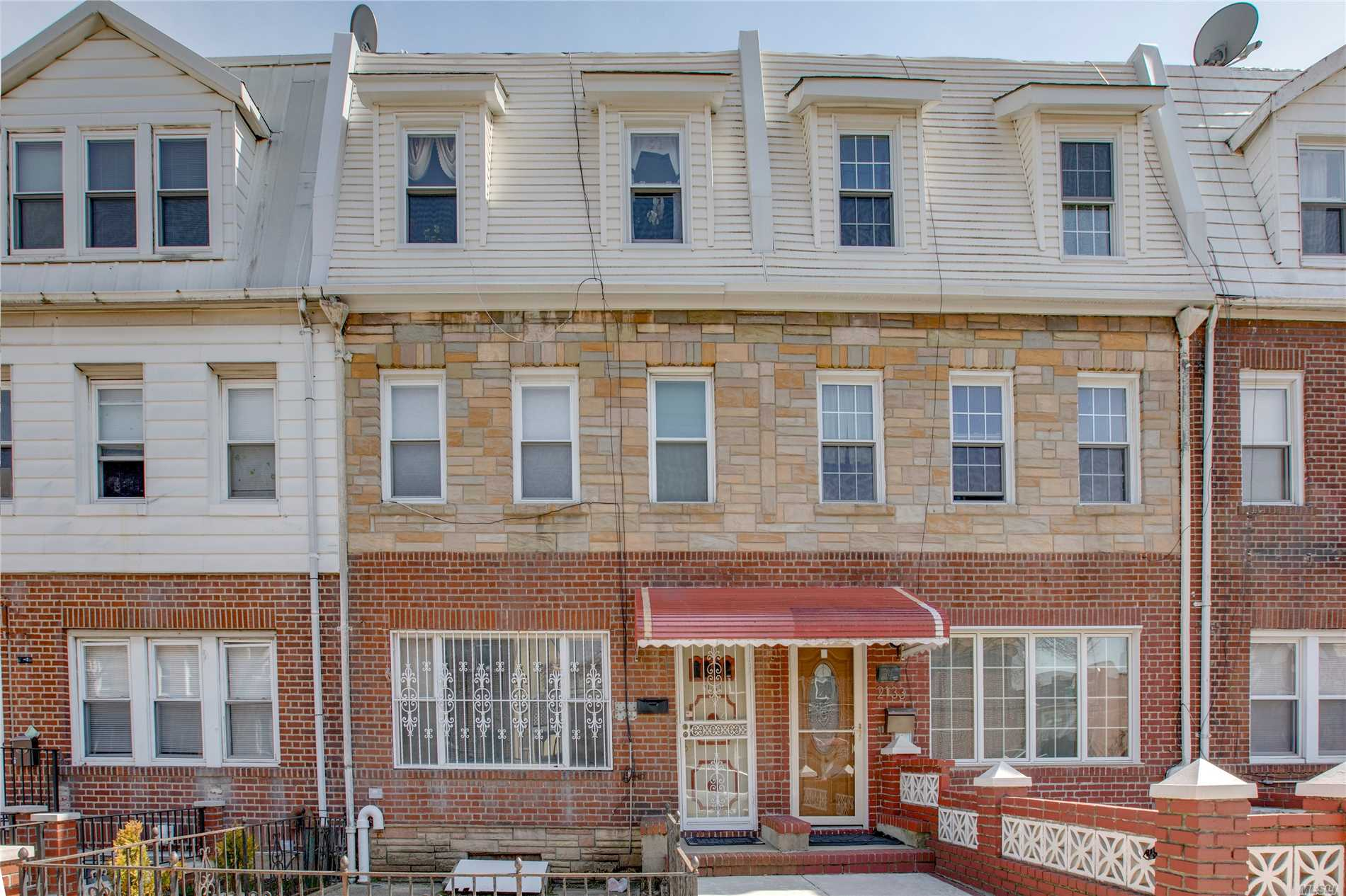 New on the Market!! Lower Ditmars Legal Two family Town house with options! Home is currently used as a one bedroom simplex over a two bedroom duplex and finished basement, rear yard and a detached garage.  Potential conversion to a Three bedroom Duplex over a One bedroom Duplex apartment. Ideal location only 1/2 block to PS 122, and midway between Ditmars Blvd N, W Subway station,  many culturally enriched restaurants,  lounges and Astoria Park for recreational activities.