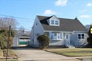 Tastefully Updated Wide Line Cape In The Dogwood Section, All New Roof, Windows and Siding, Inviting New Kitchen With Stainless Steel Appliances and Quartz Counter Tops, 2 New Full Bathrooms and Heating System, Also Features A Large Park Like Backyard and a Full Finished Basement! Great Low Taxes !!