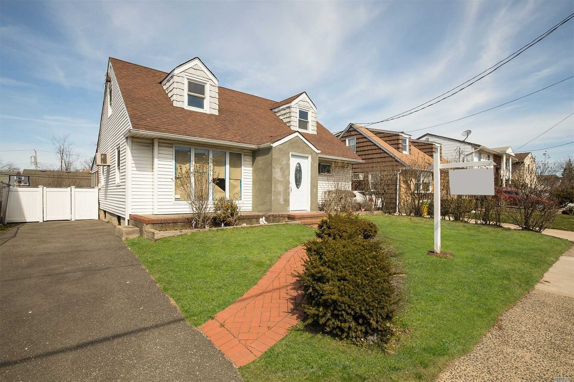 Renovated 3 BR Cape. New Appliances and Cabinets. Floors Refinished. New Bathroom Fixtures.