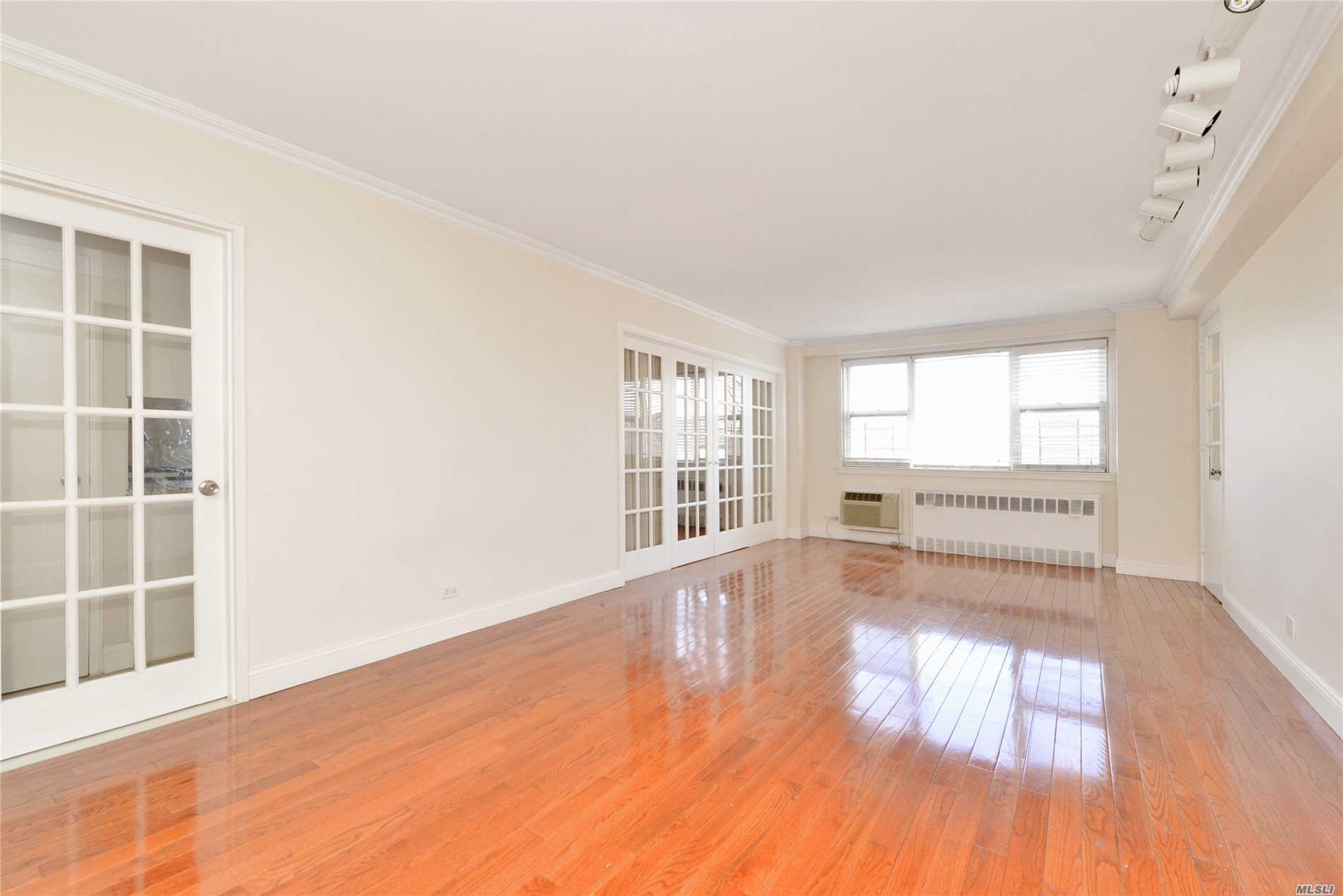 Sunny, Gorgeous And Convenient 3Br, 2 Bath Corner Apt with Large Balcony In The Heart Of Forest Hills. 24 Hr Doorman In A Well Maintained Fireproof Concrete Building With Newly Renovated Hallways and bike rack in basement. Less Than 5 Min Walk To E, F, R, M Train And Steps To Shopping And Restaurants. Zoned For Ps 196 And Ps 303. Small dogs and cats allowed. No flip tax. 20% down payment required.