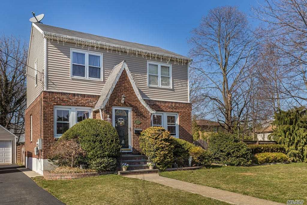 Charming *Like New* Colonial (on 84x100) W/ Balanced Combination Of Old World Qualities And Modern Functionality-- Very Bright, Open Feeling Throughout, Impeccably Maintained, Kitchen Redone 4 Years Ago, Gleaming Hardwood Floors, Updated E-I-K & Baths. Finished Bsmt Feels Perfect For Den/Play-Room Atmosphere. Home Sits On Sprawling Property (double lot) W/ *Detached Garage* + Tremendous Yard Space + Ideal Location at end of Dead-End Street In Private Yet Convenient Block/Section Of N. Bellmore!