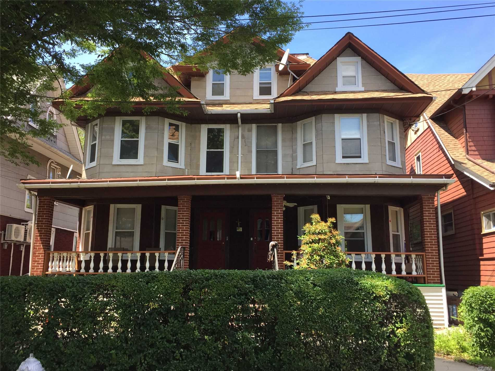 Rare find!! Unique 3 family home with private driveways and 2 car garage. The right side is a 1 family home with 5 bedrooms, 1 bath, full basement with gas boiler. The left side is a 2 family home with 1st floor 1 bedroom apt and 2nd floor 3 bedroom apt, full basement with its own boiler and wrap around porch Close to J train, prime location.