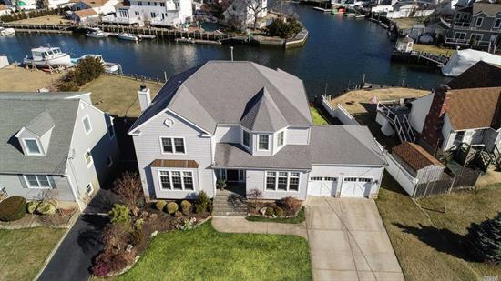 Welcome home to this stunning Mandalay waterfront colonial radiating with strict attention to detail. Features custom woodwork, high ceilings, exquisite water views throughout the home, gourmet kitchen w/ stainless, high-end appliances, wood-burning fireplace w/ layered stone wall, grand master suite w/tray ceiling, WIC & bath w/ jacuzzi tub overlooking the wide canal, Ipe wood bi-level deck, gas line for bbq, new aluminum ramp, catwalk with power, 60ft bulkhead, 9ft elevation..Truly a must see!